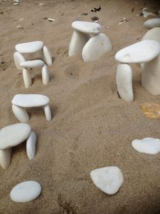 White pebble henge art on the beach