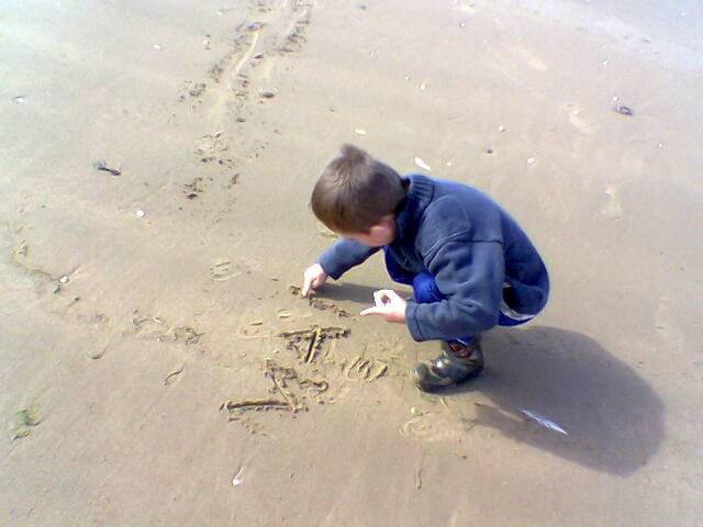 writing name in the sand