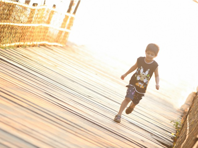 child running outdoors and being active